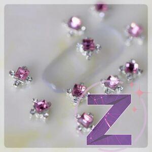 zodiac körömékszer rózsaszín központi kővel