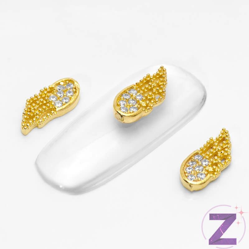 zodiac körömékszer arany színű angyalszárny cirkónia kövekkel