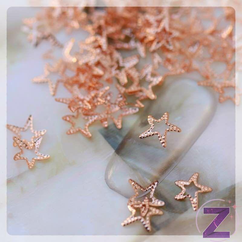 körömdekoráció tengeri csillag formában rose gold színben