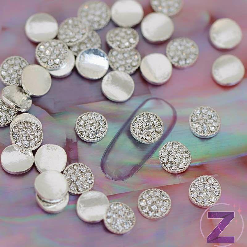 zodiac körömékszer ovális formában crystal színű strasszkövekkel